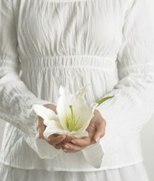 woman_holding_lily_42-15727942